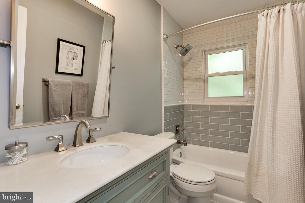 renovated hall bathroom with large vanity - 3831 N ABINGDON ST, ARLINGTON
