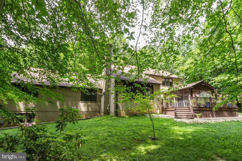 Exterior - back of home showing Deck and yard - 17007 BARN RIDGE DR, SILVER SPRING