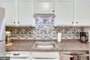 New backsplash  & Refreshed Cabinets - 6280 EDSALL RD #201, ALEXANDRIA