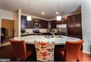 Oversized kitchen Island with pendant lighting - 160 BURLEY ST #101, STAFFORD