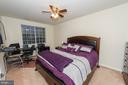 Master bedroom with ceiling fan - 160 BURLEY ST #101, STAFFORD