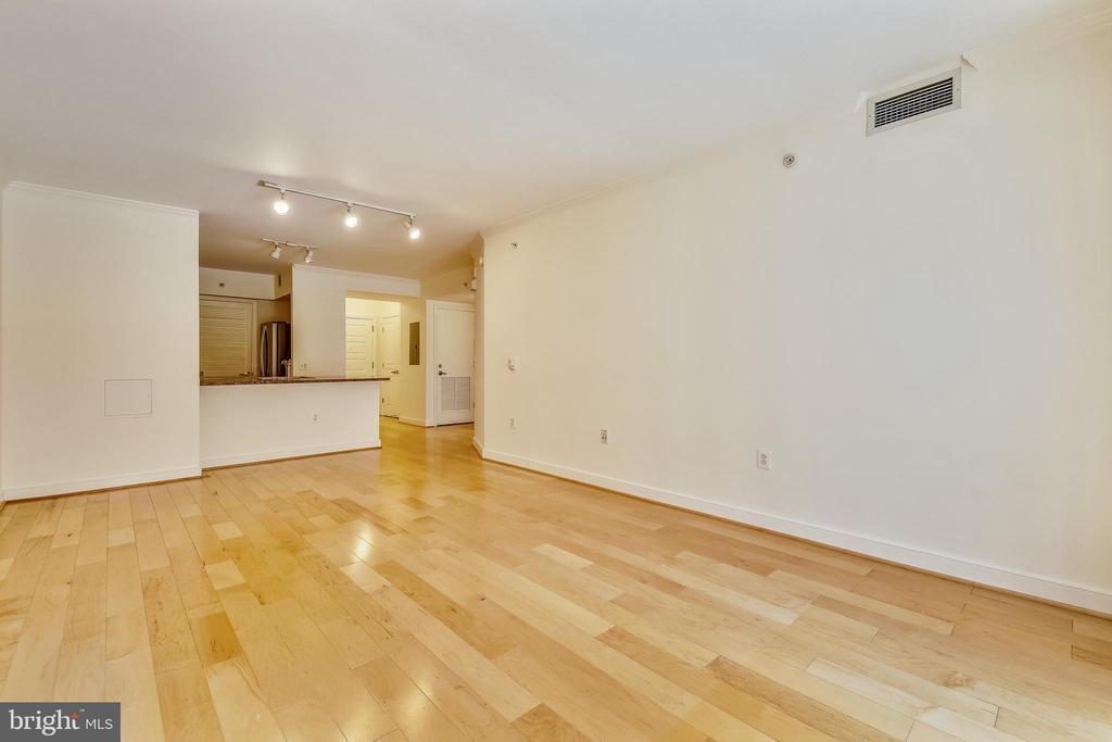 Living Room Opens to Kitchen - 616 E ST NW #302, WASHINGTON