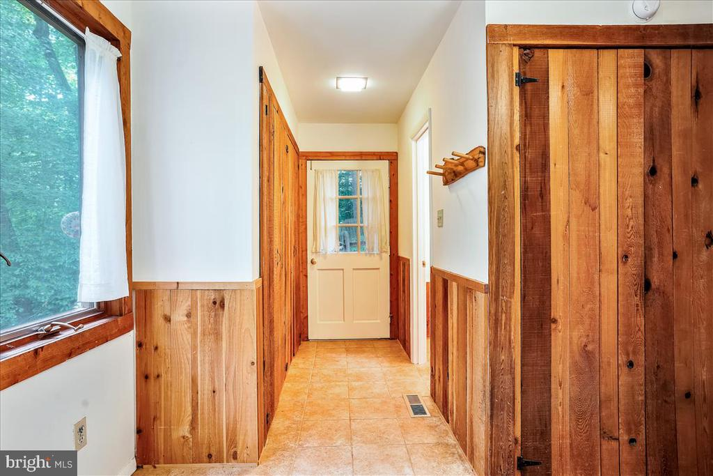 Laundry room and 1/2 bath. - 7447 CLIFTON RD, CLIFTON