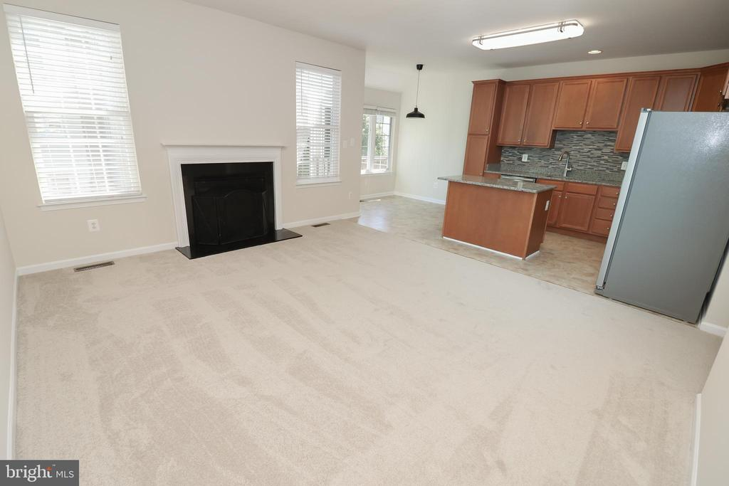 Family Room with gas fireplace of the Kitchen - 25236 WHIPPOORWILL TER, CHANTILLY