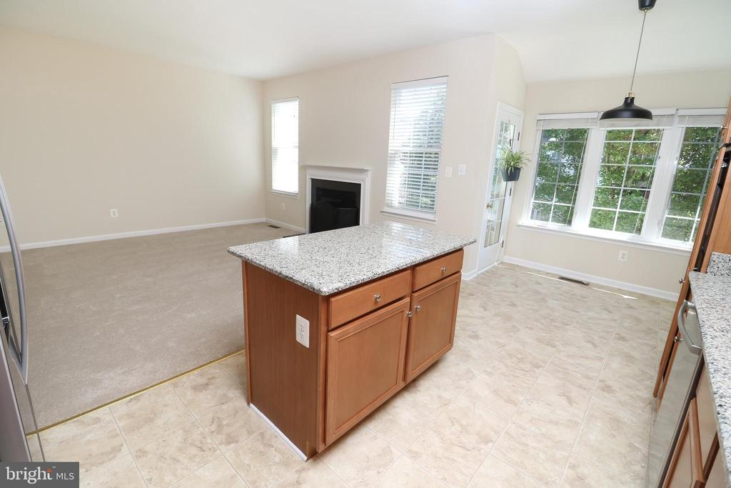 Kitchen opens up to the Family Room - 25236 WHIPPOORWILL TER, CHANTILLY