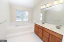 EnSuite Master Bathroom with soaking tub - 25236 WHIPPOORWILL TER, CHANTILLY