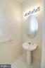 Powder Room on lower level - 25236 WHIPPOORWILL TER, CHANTILLY