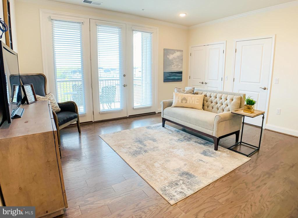 Living room with access to deck - 23631 HAVELOCK WALK TER #303, ASHBURN