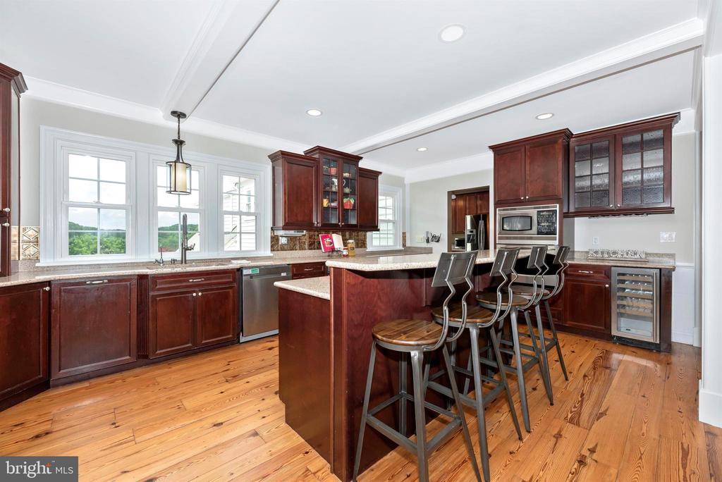 Kitchen has Silestone Counters and Cherry Cabinets - 3842 MOUNT AIRY DR, MOUNT AIRY