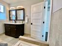 Dual vanity with curved detail. - 705 N BARTON ST, ARLINGTON