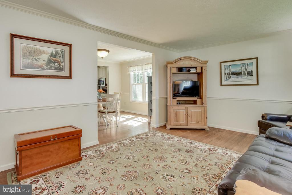 Living Room - 10 X 19 - RICH OAK WOOD FLOORS - 8705-B N PACIFIC CT, MIDDLETOWN