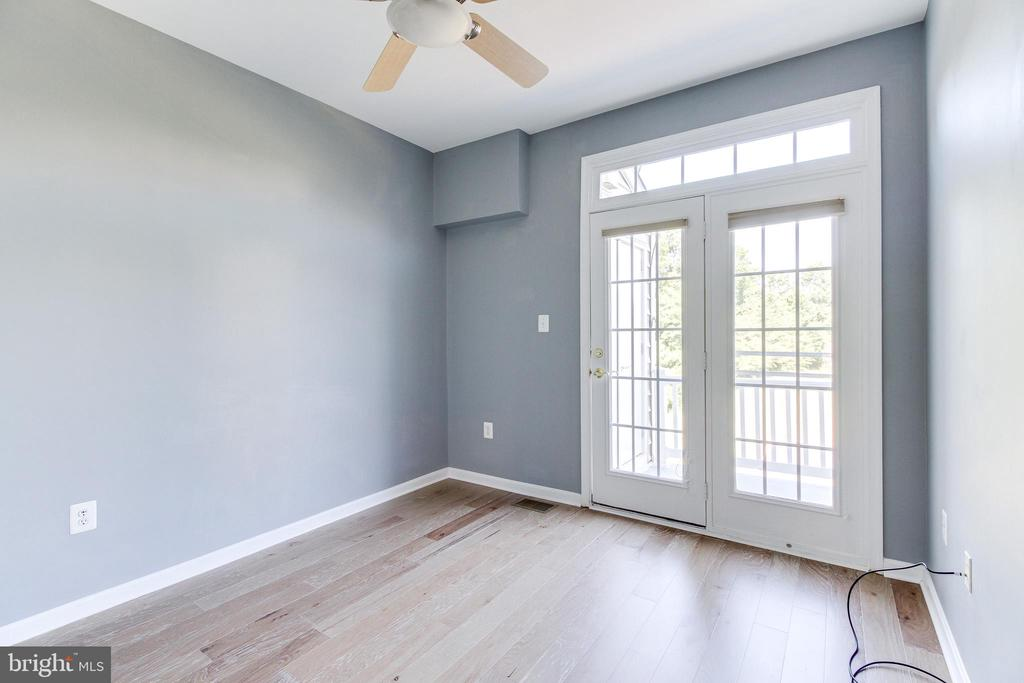 Bedroom #2 with Balcony Access - 7166 LITTLE THAMES DR #181, GAINESVILLE