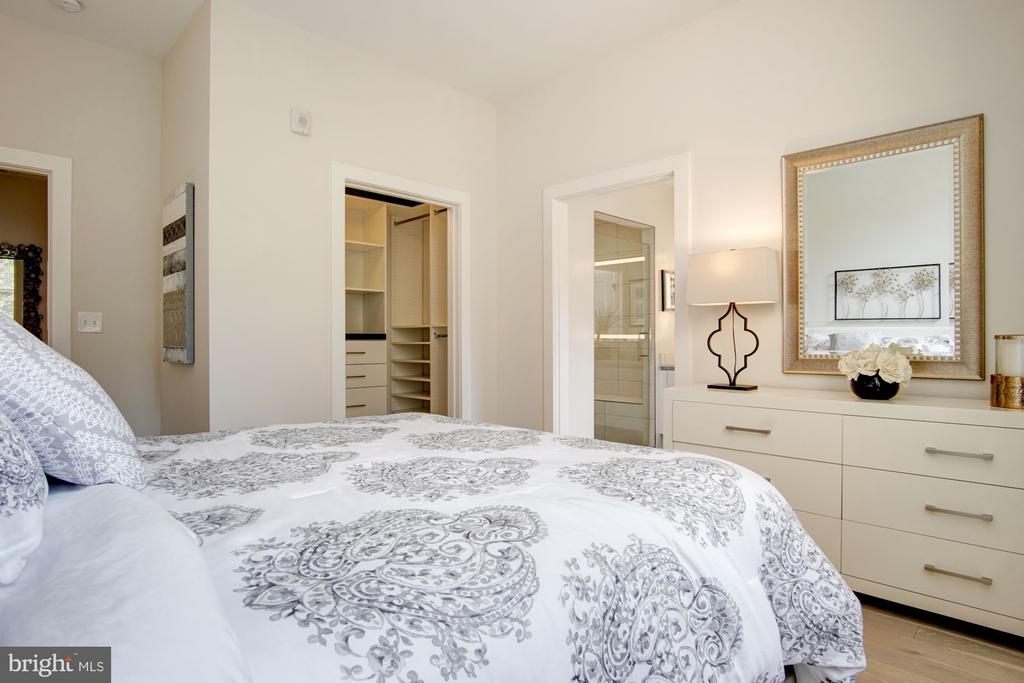 Master bedroom with en suite bathroom. - 1745 N ST NW #211, WASHINGTON