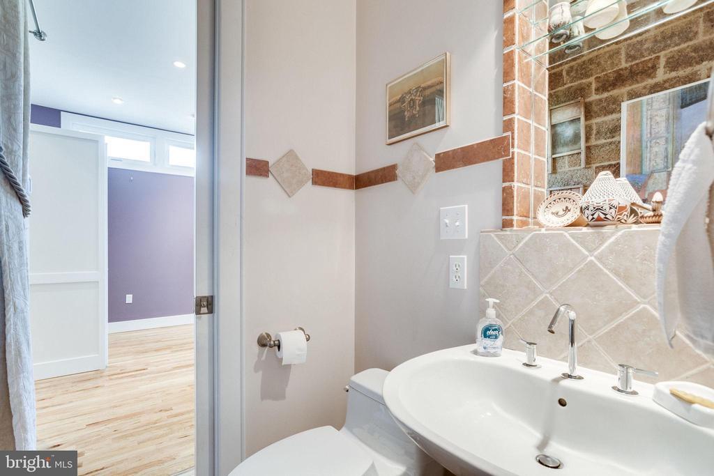 Convenient first-floor powder room - 1504 IRVING ST NE, WASHINGTON
