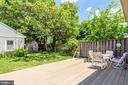 Back yard with lush gardens and two-car garage - 1504 IRVING ST NE, WASHINGTON