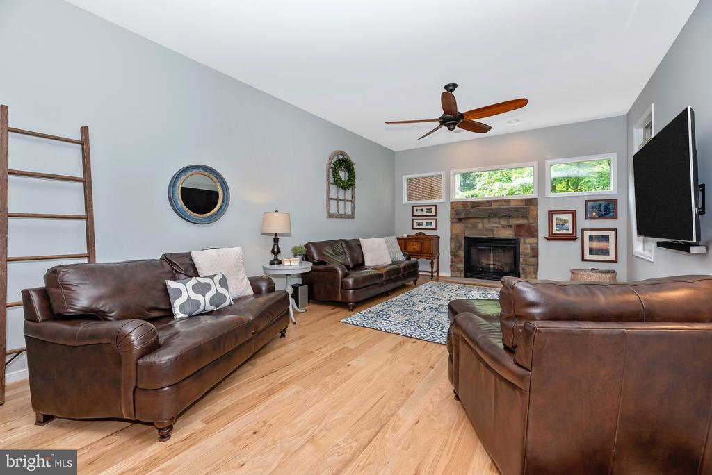 Living space with fireplace - 6799 ACCIPITER DR, NEW MARKET