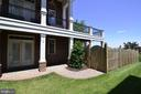 Side paver patio leads to beautifully fenced yard. - 18992 COREOPSIS TER, LEESBURG