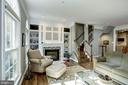 Custom bookshelves surround a TV nook & fireplace - 1330 N ADAMS CT, ARLINGTON