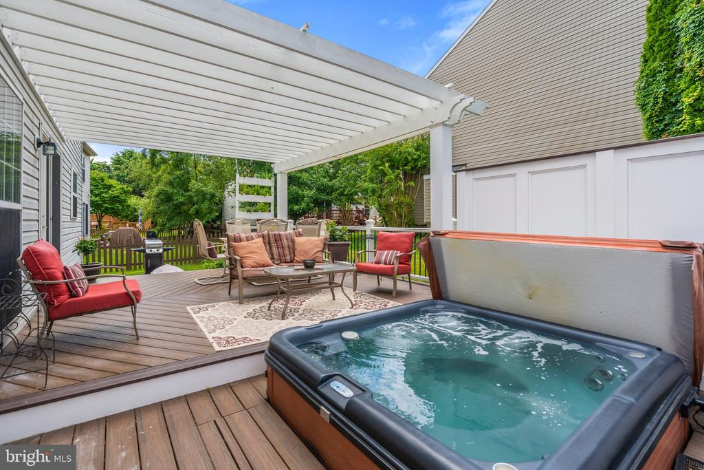 Sit a spell in your private hot tub. - 6908 SUSQUEHANNA RD, GAINESVILLE
