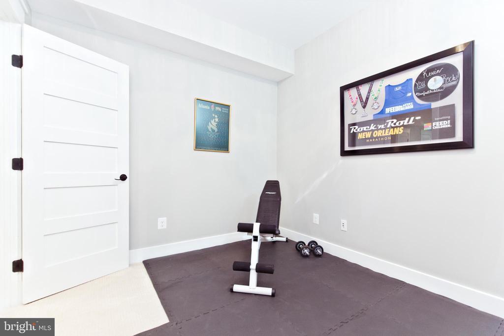 Exercise room/office/den in the basement - 3000 12TH ST S, ARLINGTON