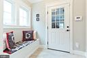 Mudroom with closet and storage bench - 3000 12TH ST S, ARLINGTON