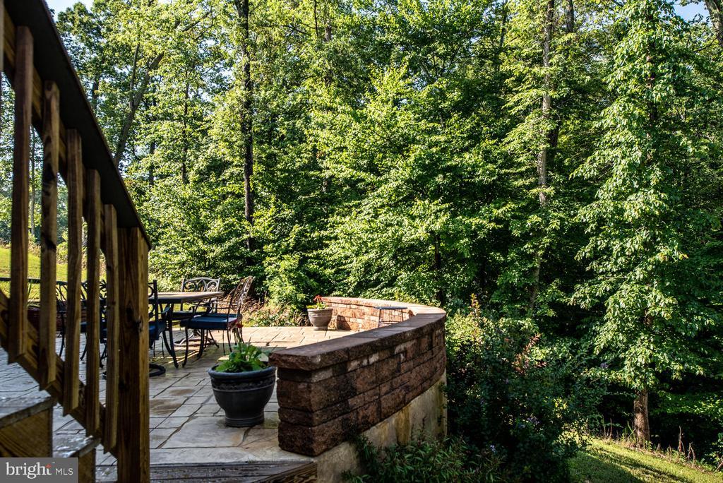 Deck to custom stone patio - 4950 CAMP GEARY LN, STAFFORD