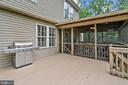 Nice deck attached to porch with steps to patio - 20311 BROAD RUN DR, STERLING