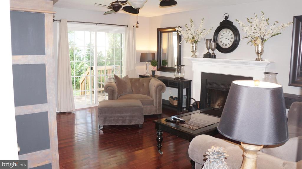 Family room with a deck and wood burning fireplace - 12 DUDLEY CT, STERLING