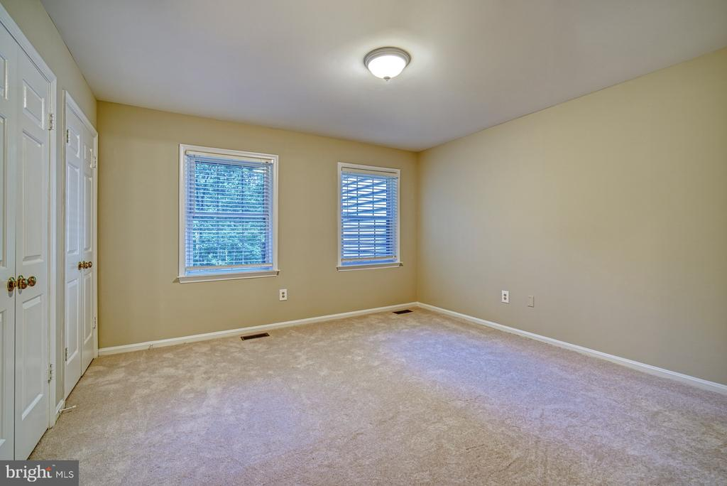 Bedroom 2: Front of property, two closets - 12302 CANNONBALL RD, FAIRFAX