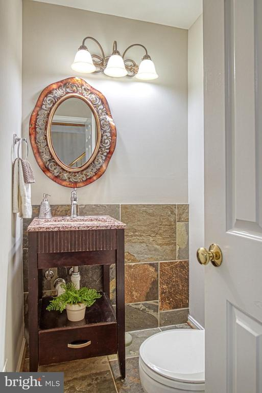Main level powder room with slate details - 12302 CANNONBALL RD, FAIRFAX