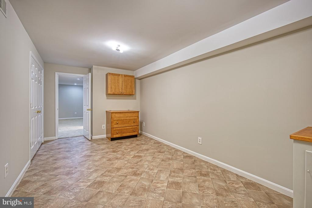 Lower level den with bulk-head walk-up stairs - 12302 CANNONBALL RD, FAIRFAX