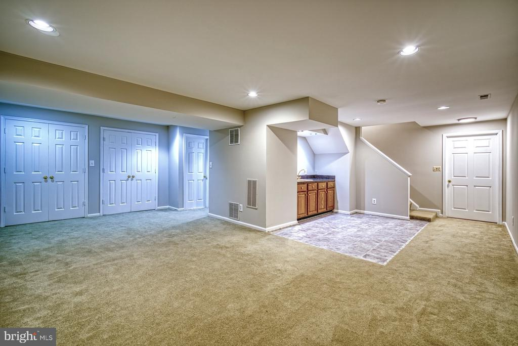 Huge recreation room with lots of storage - 12302 CANNONBALL RD, FAIRFAX