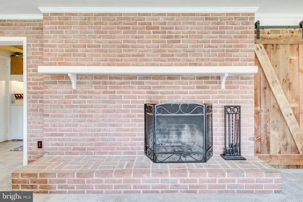 fireplace with custom barn door - 2718 FOX MILL RD, OAK HILL