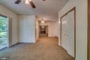 Master bedroom with sliding door to backyard deck - 6407 DEERSKIN DR, FREDERICKSBURG