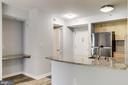 Kitchen with breakfast bar and desk area - 1000 NEW JERSEY AVE SE #202, WASHINGTON