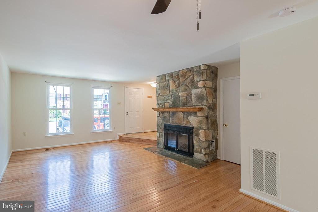 Living Room with Stone Surround Fireplace - 10227 QUIET POND TER, BURKE