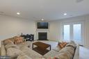 Basement Rec room with corner fireplace - 40594 SCULPIN CT, ALDIE