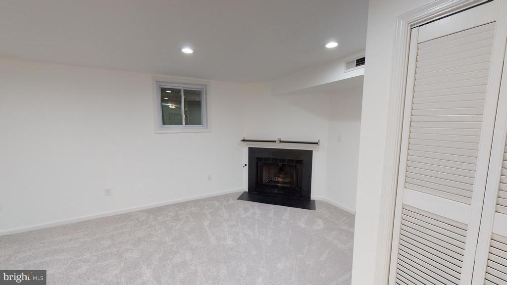 Lower level rec room with gas fireplace - 13616 WILDFLOWER LN, CLIFTON