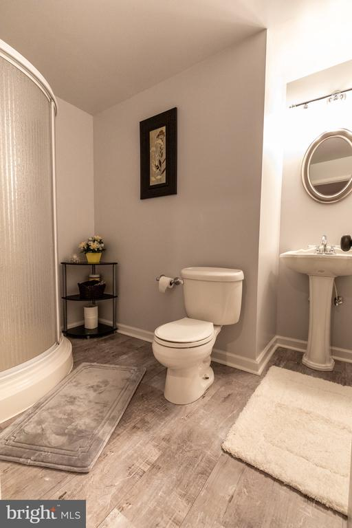Full bath in basement with new flooring - 144 PEBBLE BEACH DR, CHARLES TOWN