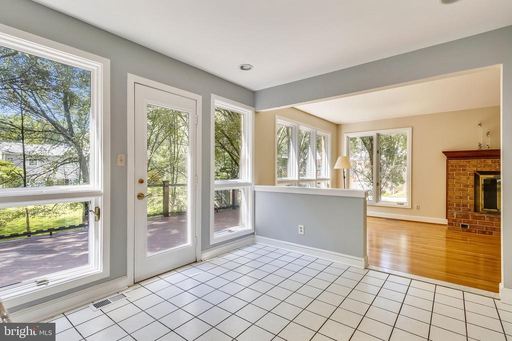 Kitchen with large windows and door to deck. - 4103 FAITH CT, ALEXANDRIA