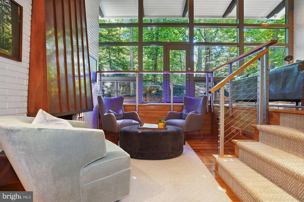 Lower Den with Copper Hooded Fireplace - 3421 STONEYBRAE DR, FALLS CHURCH