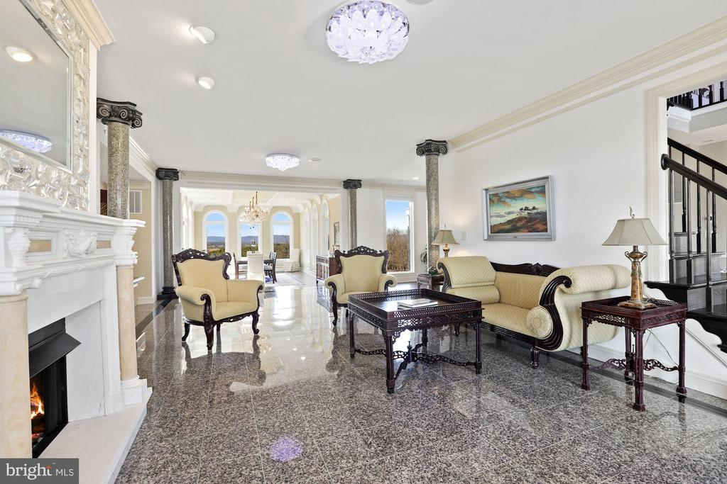 View from living room to the elegant dining room. - 15929 BRIDLEPATH LN, PAEONIAN SPRINGS