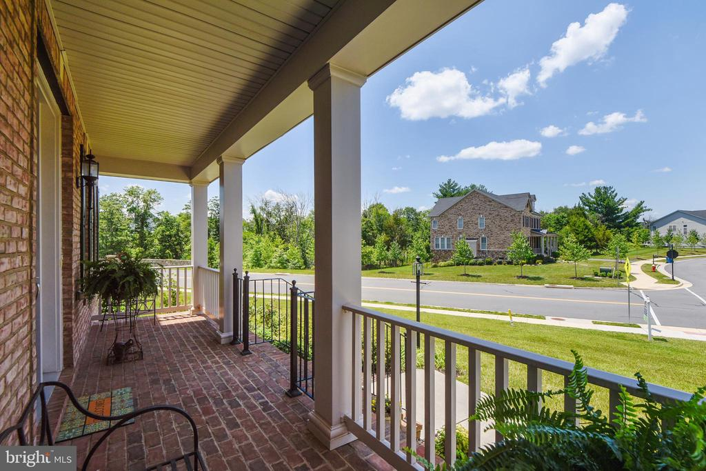Front porch is another outdoor living space - 22602 PINKHORN WAY, ASHBURN