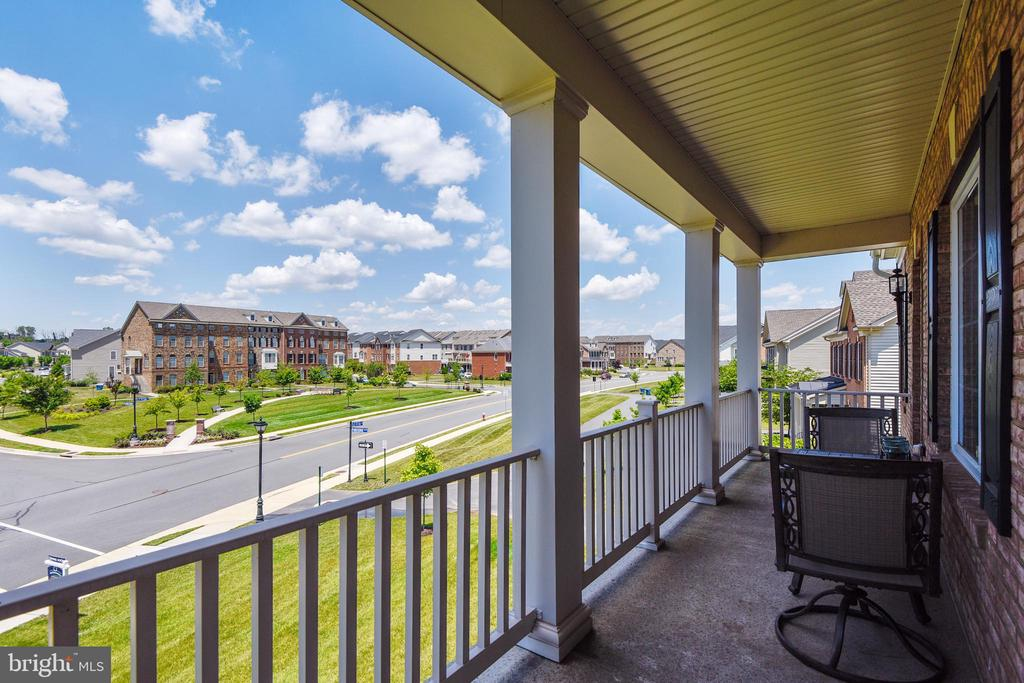 Such a fun sitting area on the upper porch - 22602 PINKHORN WAY, ASHBURN