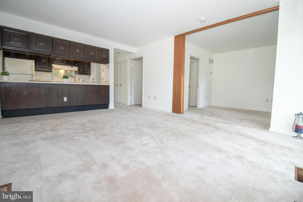 Living room towards bedroom - 3618 GLENEAGLES DR #7-1G, SILVER SPRING