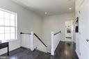 Upstairs Hallway with Oak Staircase & Wood Floors - 43051 THOROUGHFARE GAP TER, ASHBURN