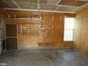 Garage left side view with shelving - 43114 LLEWELLYN CT, LEESBURG