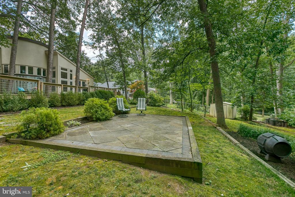 Slate patio offers views of wooded lot - 3408 GREENTREE DR, FALLS CHURCH