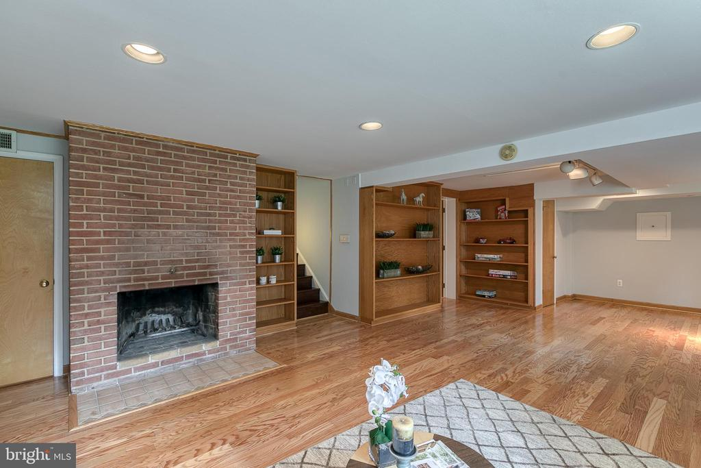 Lower level family room with fireplace - 3408 GREENTREE DR, FALLS CHURCH