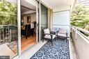Large, private patio with treetop views. - 3001 VEAZEY TER NW #508, WASHINGTON